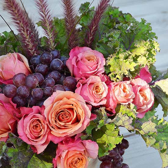 Combination of Grapes and Garden rose and also Kale as your backyard flower arrangement