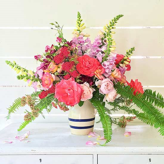 Opt for garden rose and fern as well as foxglove flower arrangements